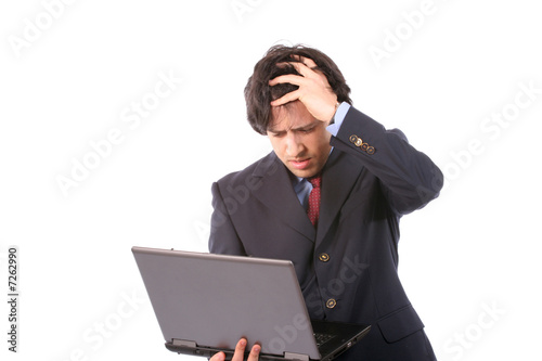 Young woried business man working with laptop