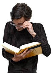 Funny student looking into a dictionary