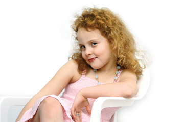 Girl 6 years old sit  like a princess and smile