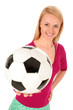 Portrait of young woman holding soccer ball