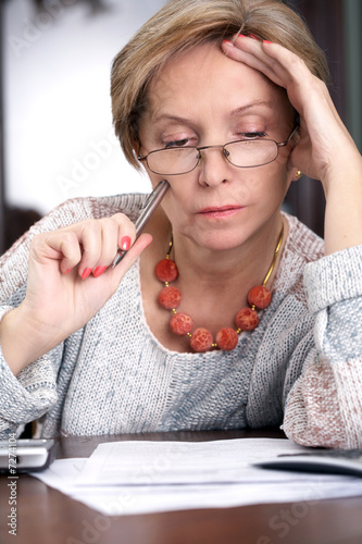 Woman sitting over documents