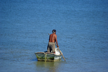 lonely fisherman going for boat trip
