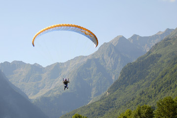 Flying paraglider in the mountains
