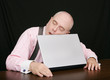 business man sleeping on his laptop