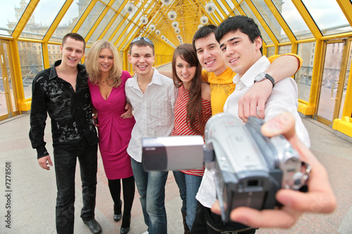 group of young persons removes itself to video camera