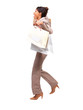 Business woman running with shopping bags