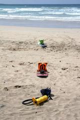 kitesurf boards and pump on beach