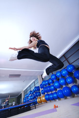 Dancing woman, happy and jumping up.