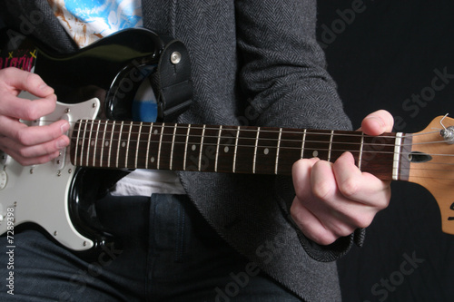 fingering cords and strumming