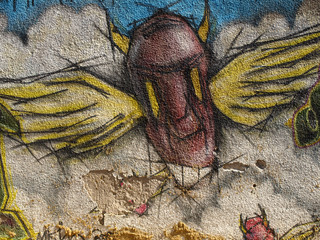 graffiti sprayed on a old wall