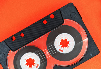 Compact cassette on an orange background