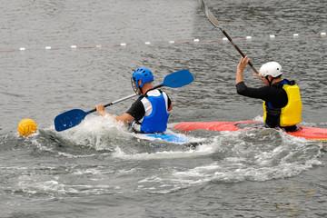 People are playing kayak polo