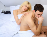 Fototapety unhappy young couple in bedroom