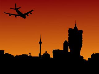 Macau skyline with plane