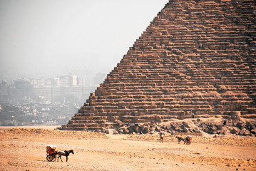 EGYPTIAN PYRAMID WITH CARRIAGE IN FIRST PLAN