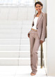 Smiling businesswoman standing against wall