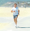 Senior man running in the sun at the beach