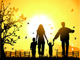 Fototapety Happy family walks on nature, sunset
