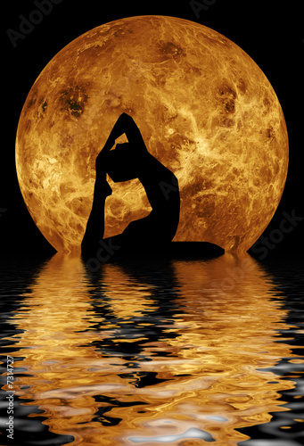 woman doing yoga on water background