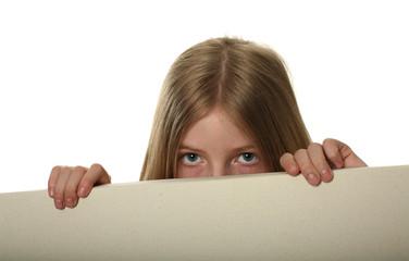 Pretty Girl Peeping Over a Blank Billboard