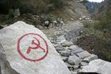 communist inscription on rock in nepal annapurna trek poster