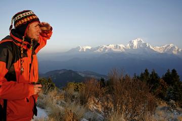 mountaineerer looking at a mountain range