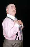 proud man holding suspenders poster