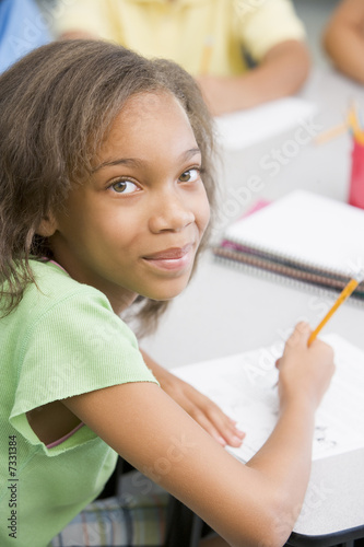 Elementary school pupil at desk