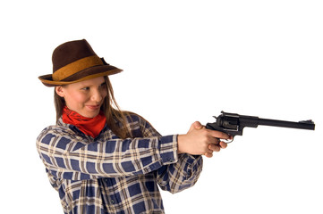 Smiling cowgirl with gun aim at someone