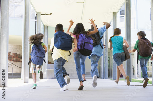Elementary school pupils running outside