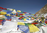 praying flags floating in the wind , annapurnas, nepal poster