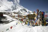 Trekker at Thorong-La pass, annapurna, nepal poster