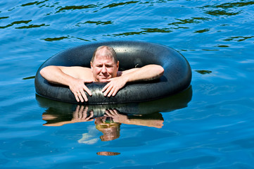 Man in Water with Tube