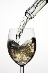 White wine pouring