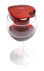 Glassy heart on a glass of wine