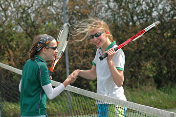 shaking hands after a game of tennis