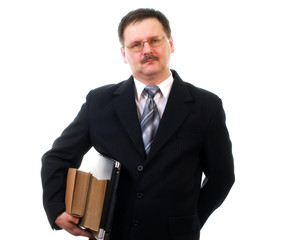 Businessman with laptop and books