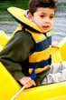 Young boy enjoying steering the pedalo
