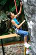 Young girl enjoying the indoor rock climbing activity.