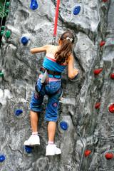 Young girl doing rock climbing