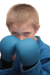 Boy with boxing gloves.