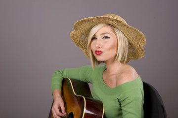 Blonde with Guitar Lips Puckered