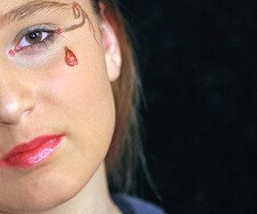 Girl With Painted Teardrop