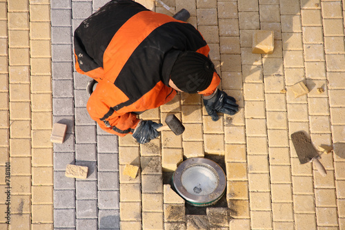 Road worker making pavement