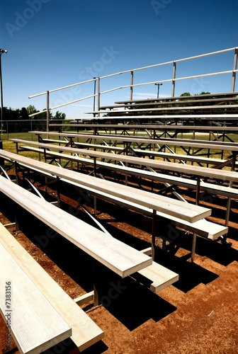 empty bleachers with no people at a baseball game.