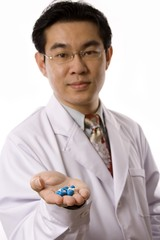 Asian Doctor With Pills