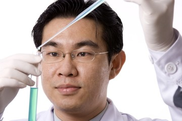 Asian Doctor With Test Tube
