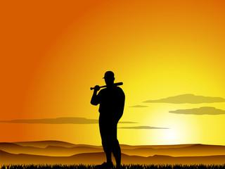 Baseball player at sunset