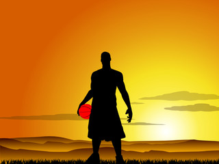 Basketball player at sunset