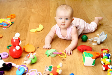 baby playing with a toy (girl 6 month)